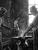 Blacksmith and helper