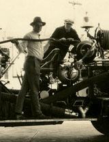Unidentified men refuel fire truck