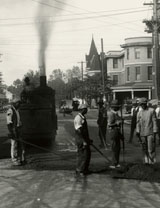 Work crew repaving street