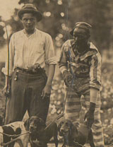 Male prisoners and guard with dogs